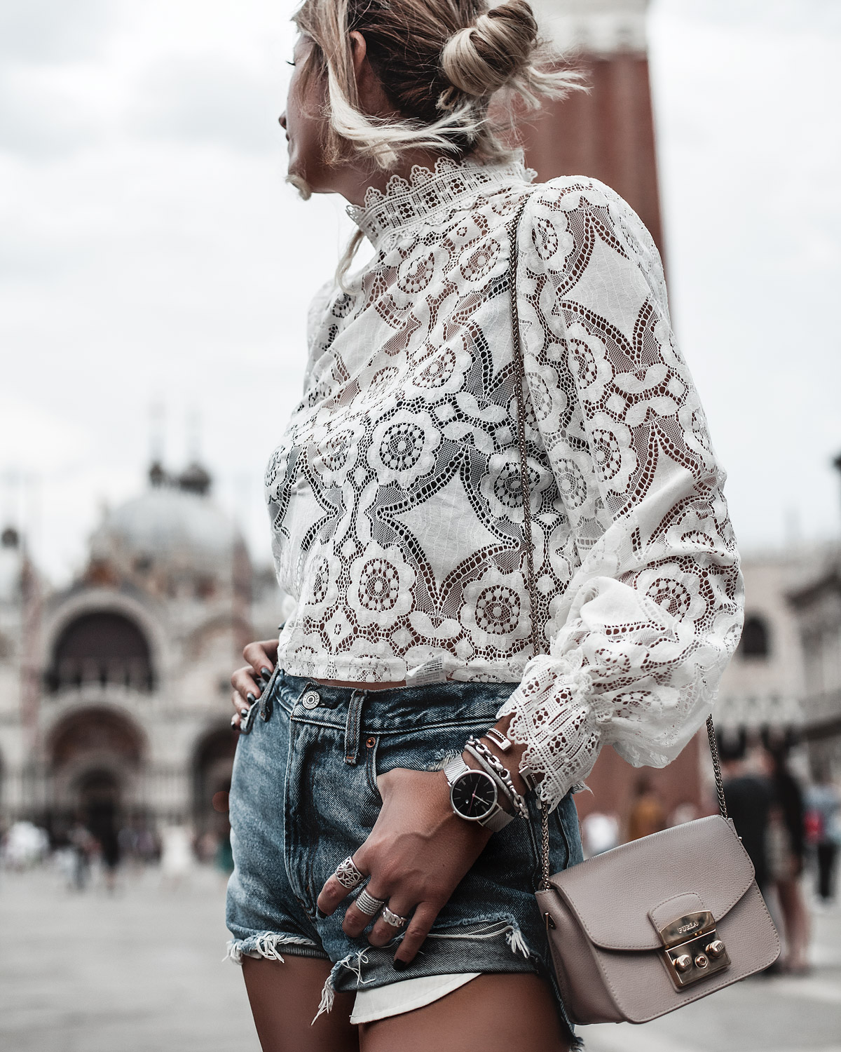 Trip to Venice wearing white lace top jeans shorts beige bag and silver jewellery