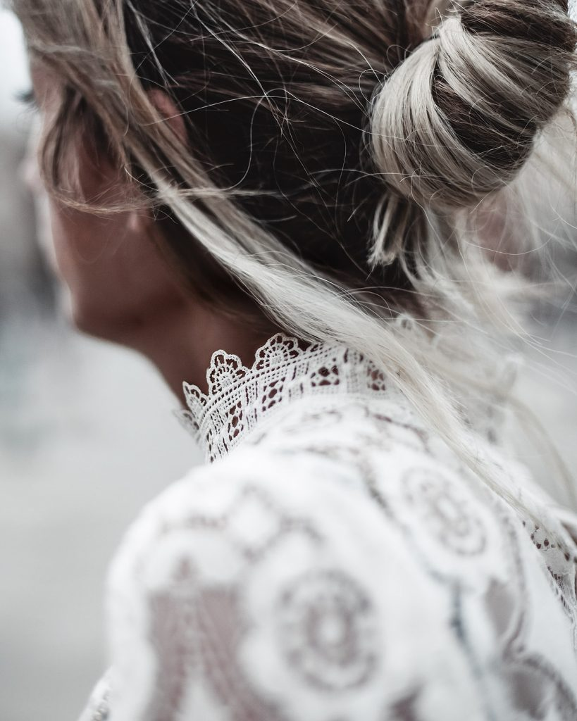 Trip to Venice wearing a bun and lace details