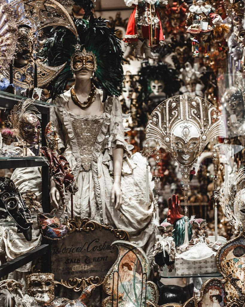 View of a shop selling carnival masks and clothes in Venice