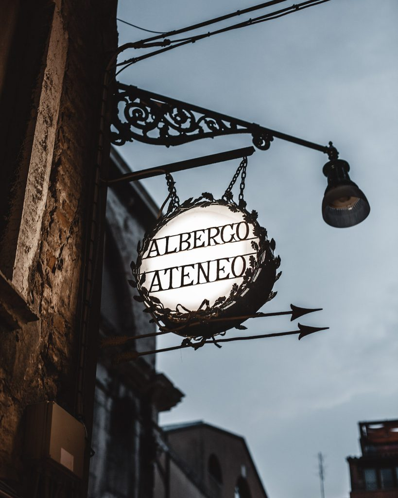 a shop sign late at evening