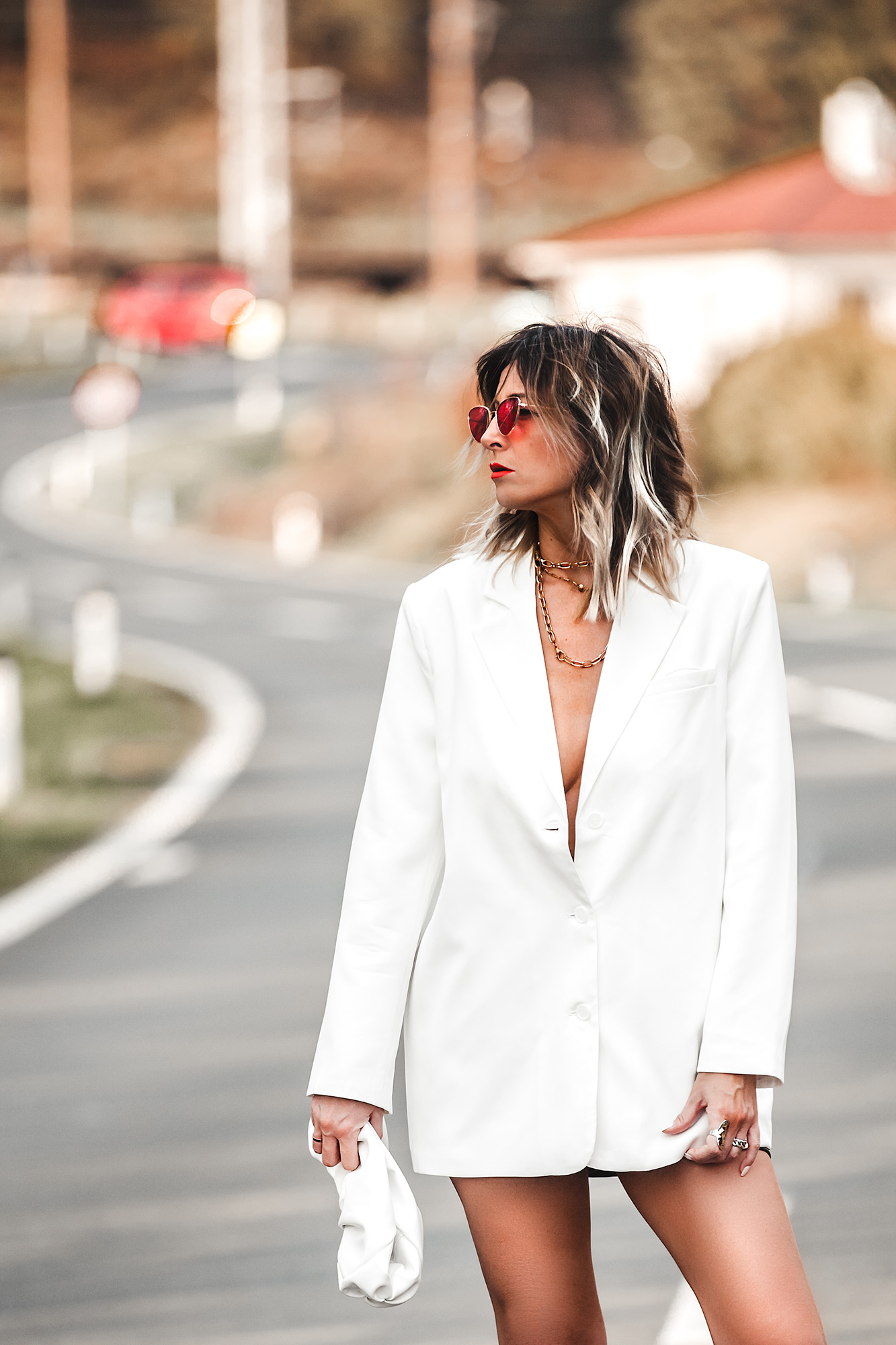 SHOULD I BUY A WHITE OR A BLACK SUIT? Both are necessary and great staples. But if you already have at least one perfect-fitting black suit then you can stop buying black and try white. Why? Because a white suit gives more room colorwise for mix-n-match combinations. Read more... White blazer, white clutch.
