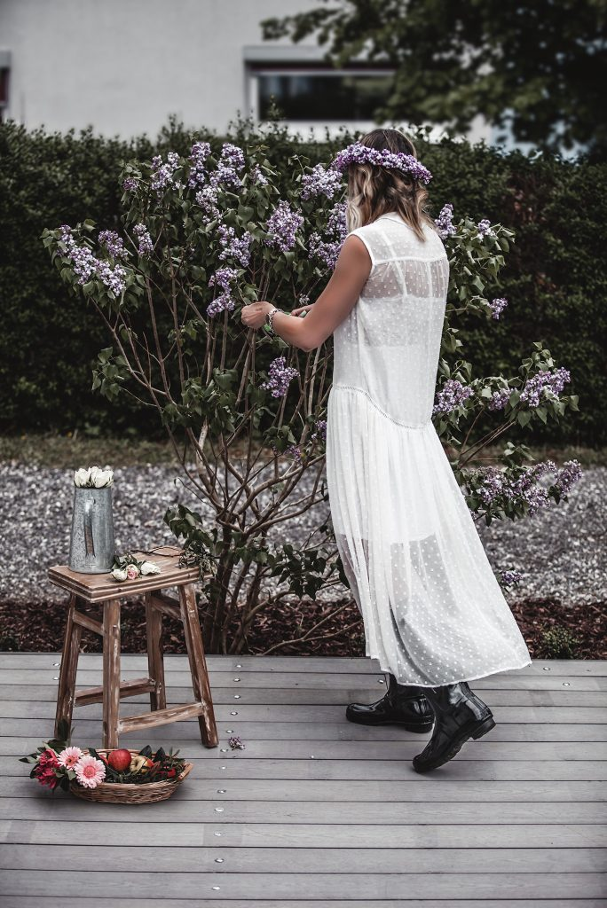 The time of white dresses is officially here. Keep reading to have a taste of the most beautiful voluminous, romantic, and broderie white dresses for spring and summer 2020, at super affordable prices, many of which are only under 30 €. White dress, Rubber Boots, Lilac, Gardening.