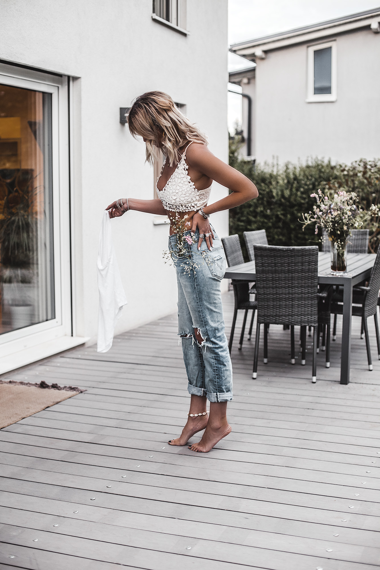 Style tip: Some bras are not made to be hidden but to be seen. Find the most beautiful lingerie on market rn to recreate the bralette with T-shirt look. Bralette and distressed jeans.